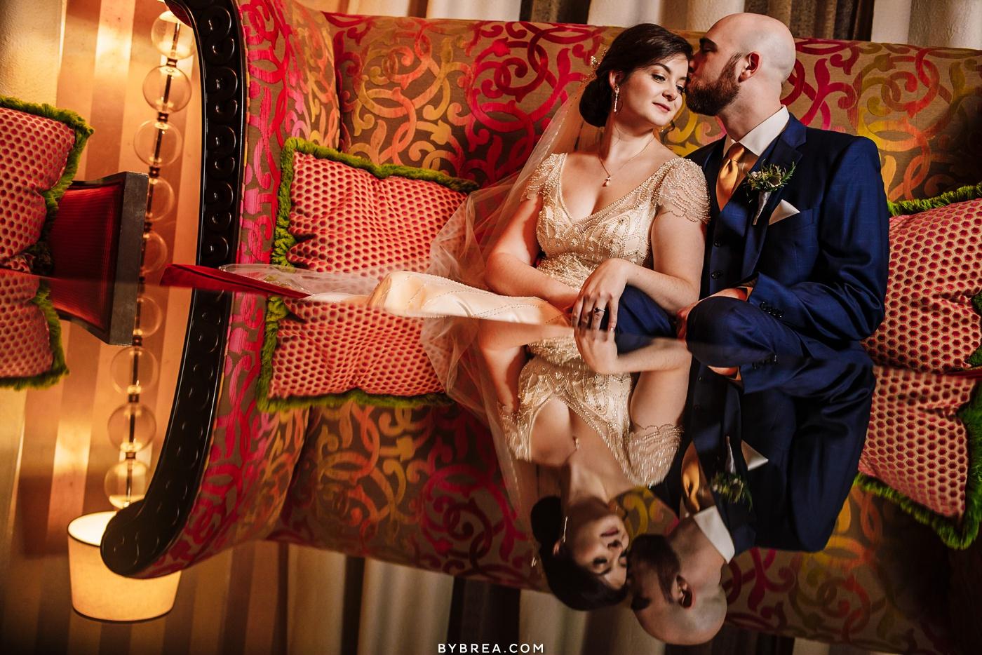 Groom kissing bride couples portraits at Kimpton Hotel Monaco