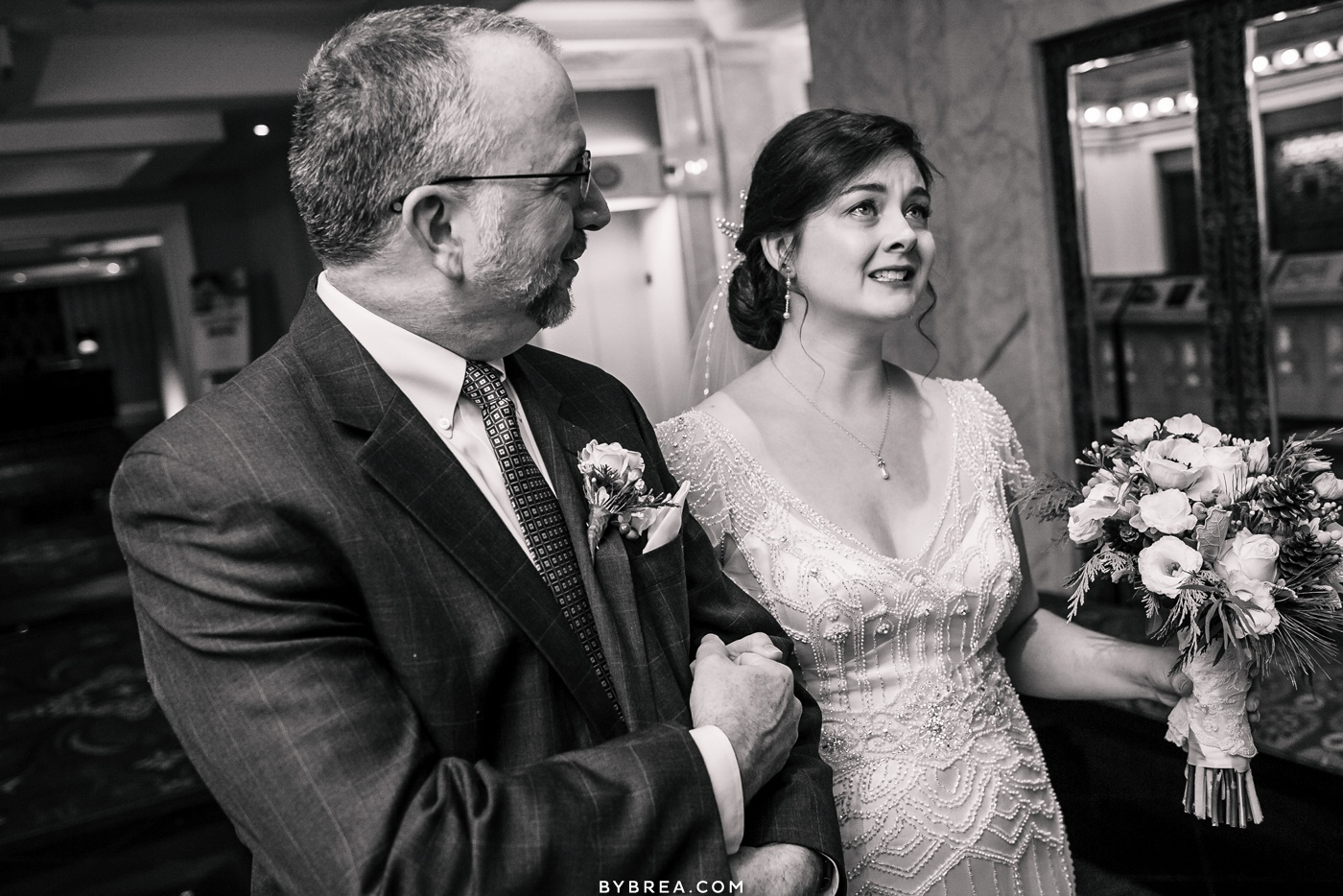 Emotional photo of bride and father before ceremony Baltimore wedding