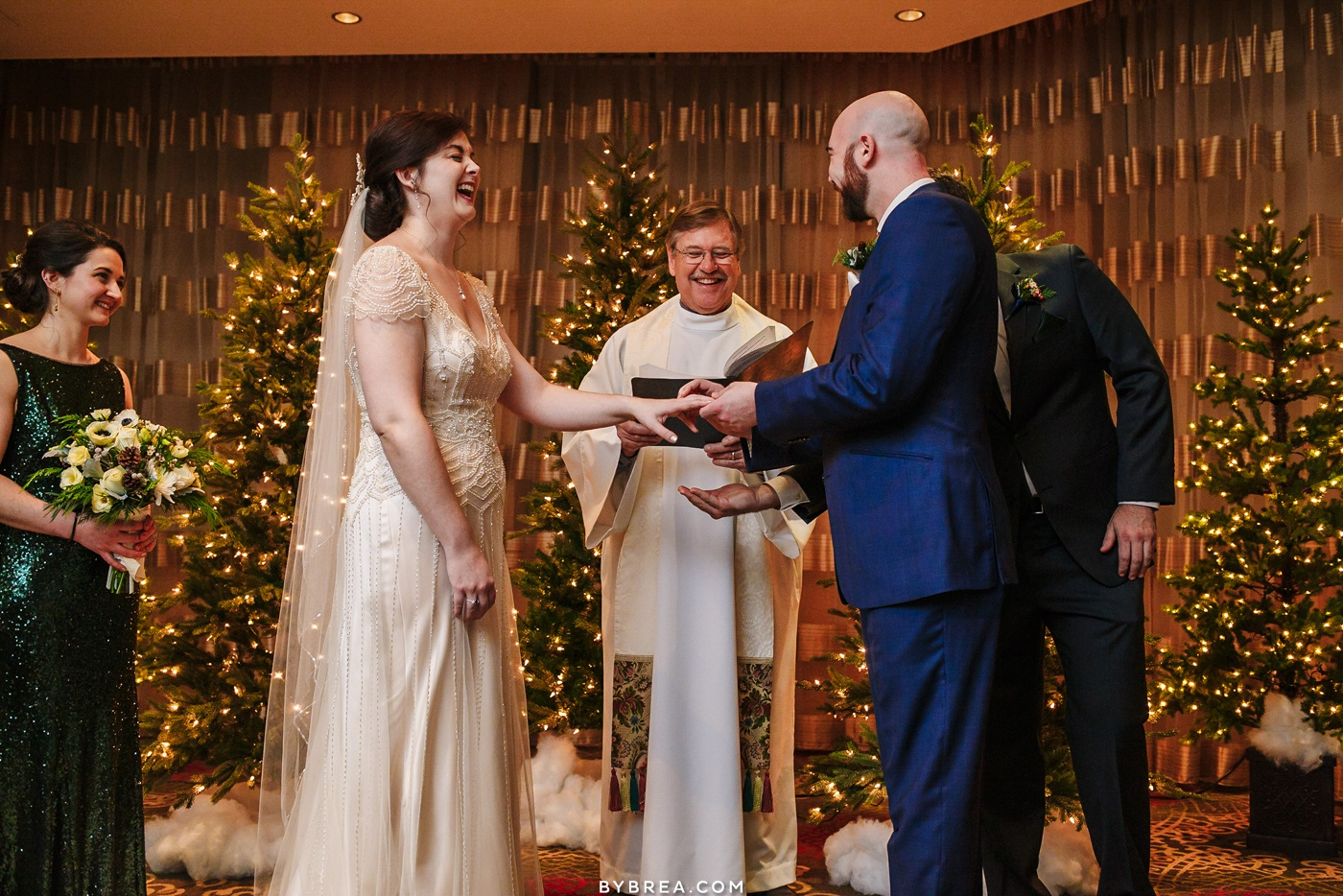 Picture of bride and groom laughing during ceremony winter wedding Hotel Monaco