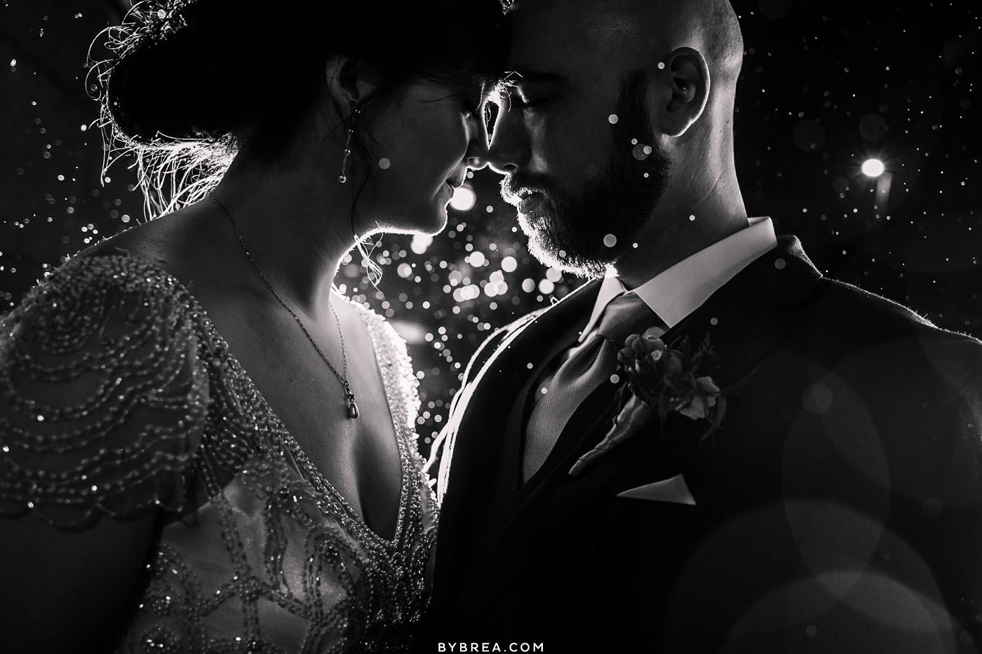 Couples portrait rain shot Baltimore wedding Hotel Monaco