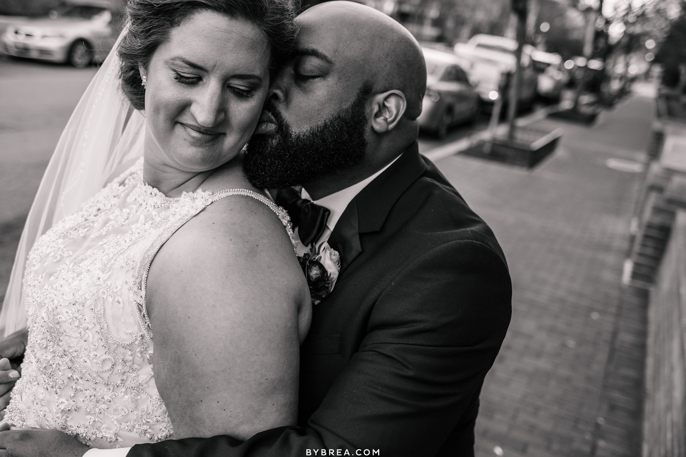 Picture of groom kissing bride during portraits wedding Washington D.C.