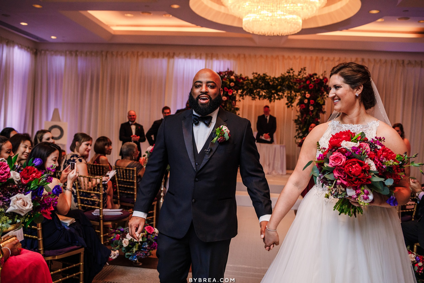 Picture of bride and groom walking out of ceremony Park Hyatt D.C. wedding