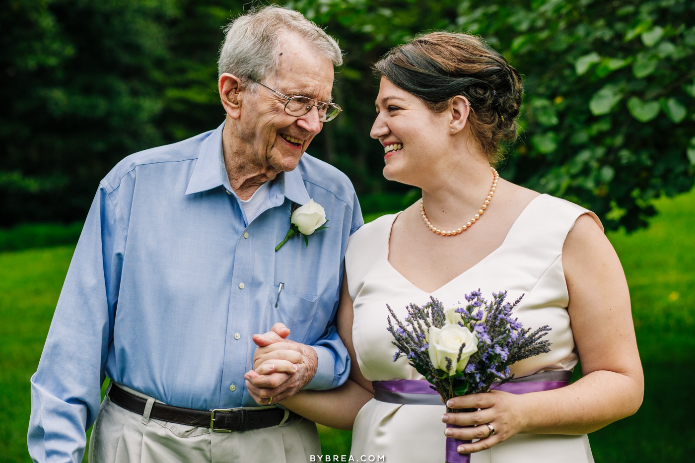 photo of bride and grandpa smiling at baltimore wedding