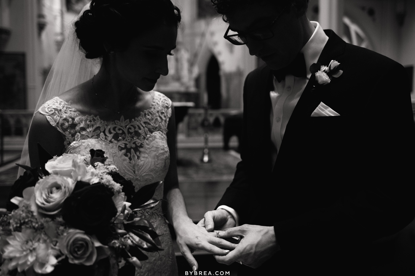 bride and groom looking at rings after ceremony