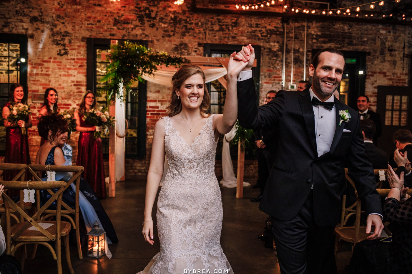 picture of bride and groom leaving ceremony at Mt. Washington Mill Dye House in Baltimore