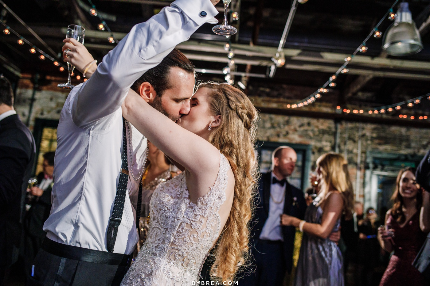 Bride and groom kiss during New Years Eve wedding at Washington Mill Dye House