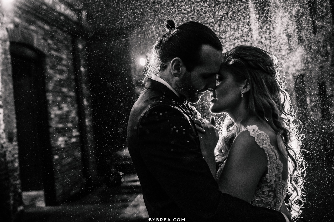 Bride and groom night time rain portrait in Baltimore