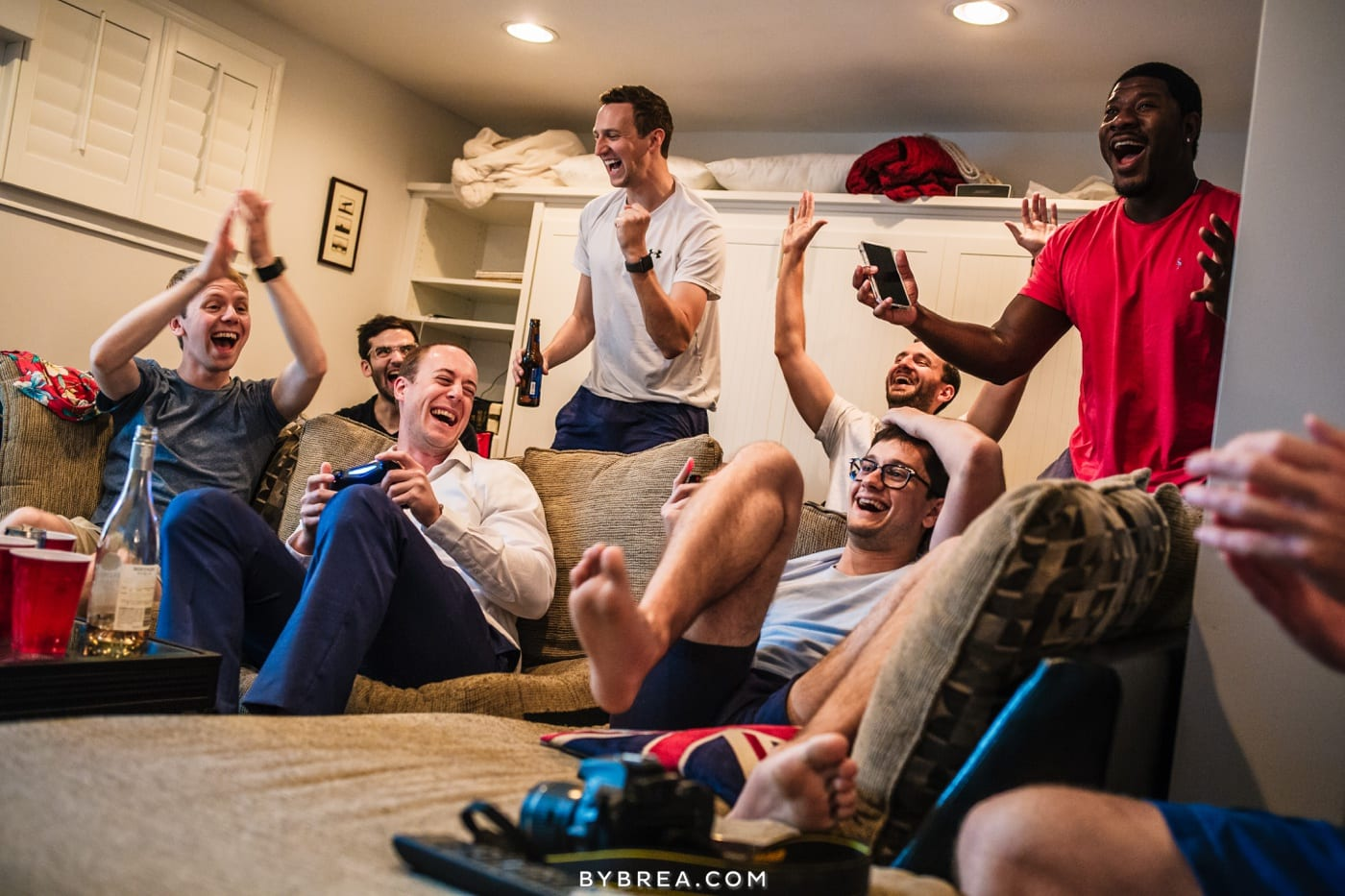 photograph of groomsmen playing video games before ceremony virginia wedding