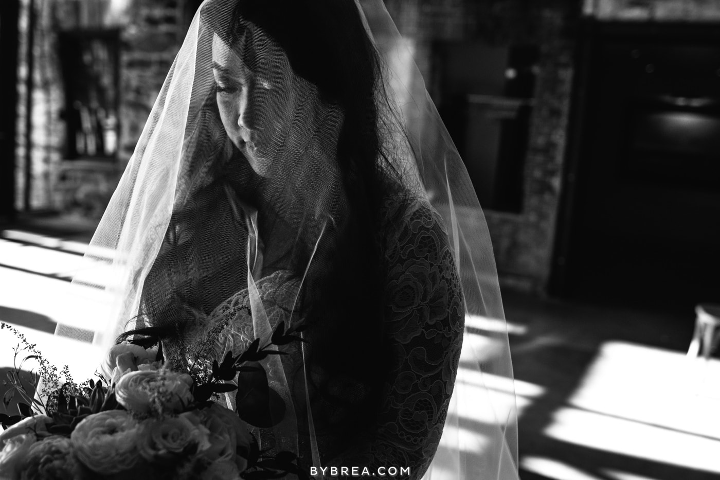 black and white photo of bride taking a moment before ceremony at Washington Mill Dye House
