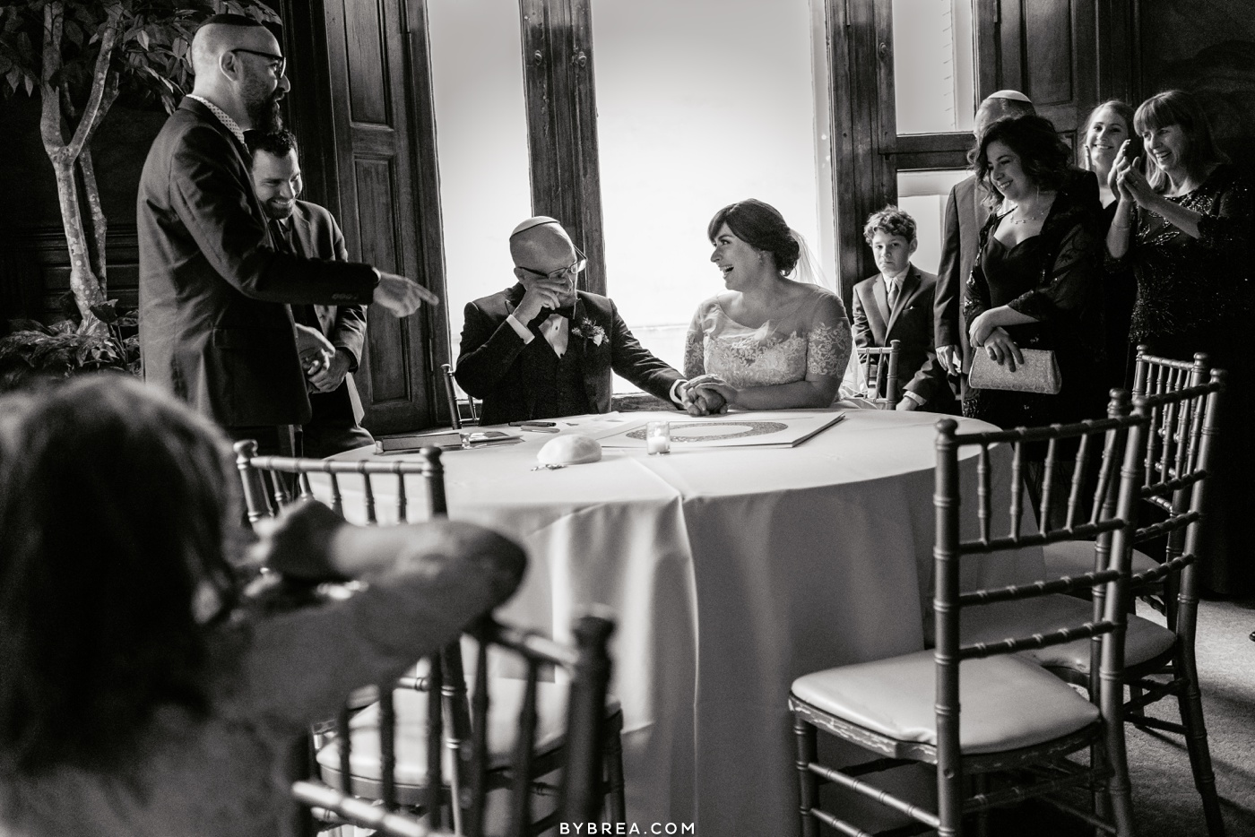 Emotional photo of bride and groom during ketubah signing at Belvedere