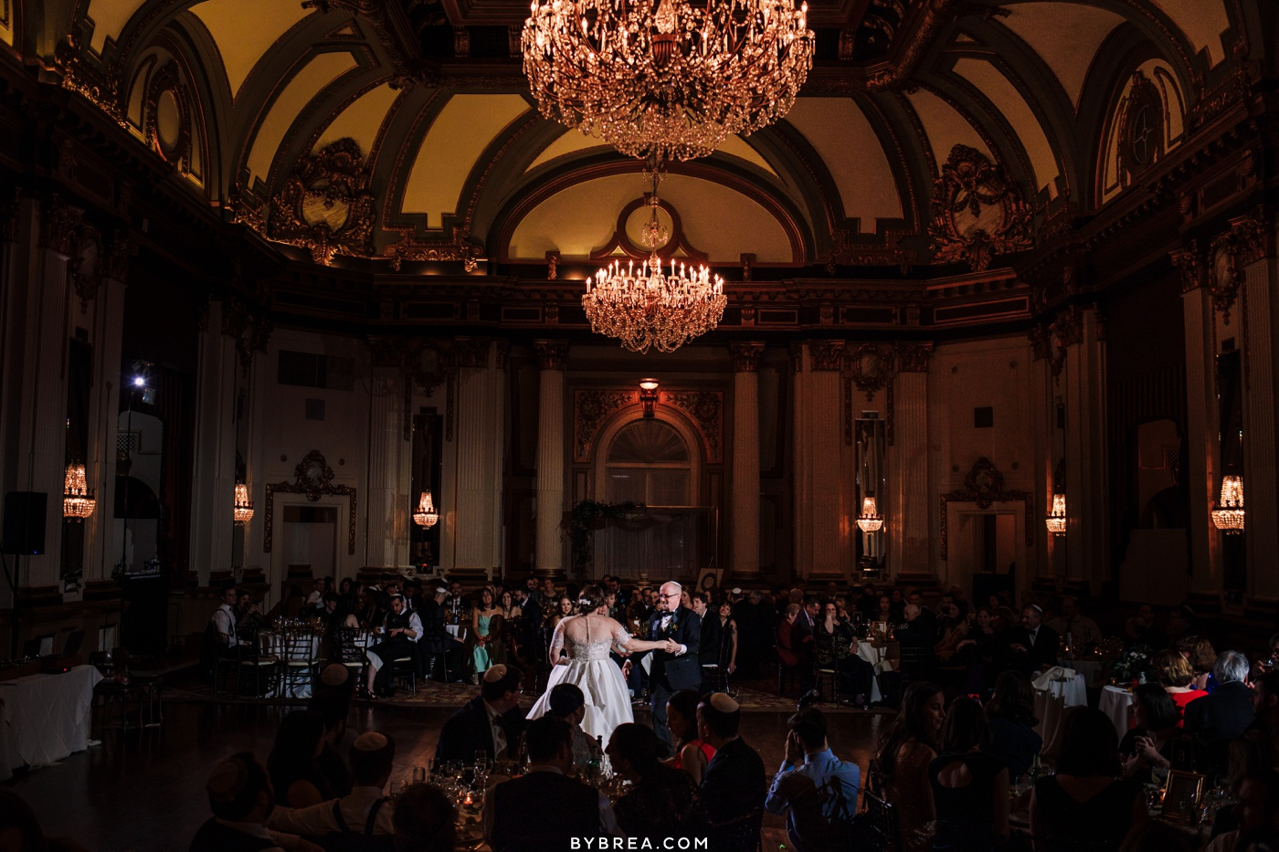 Wedding on the 12th floor at the Belvedere in Baltimore photograph of bride and groom first dance