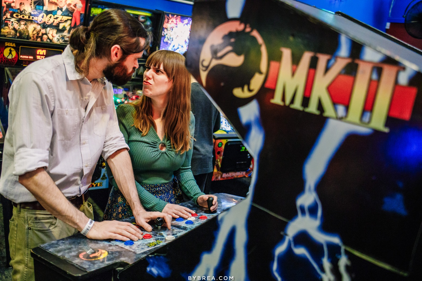 Lifestyle engagement session couple playing video games in YESTERcades Red Bank