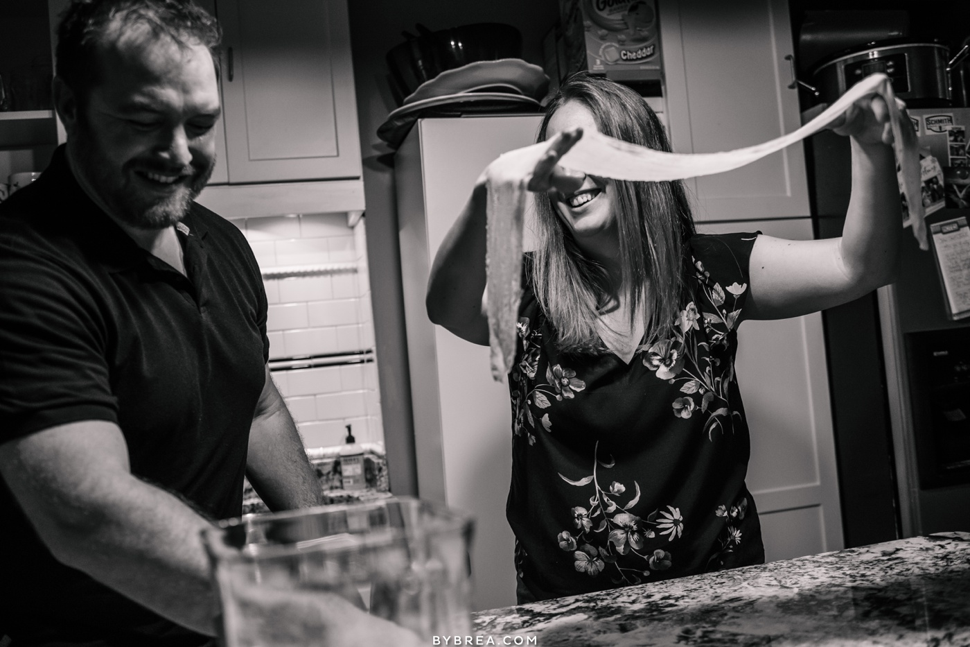 Lifestyle engagement photo couple making dinner Baltimore