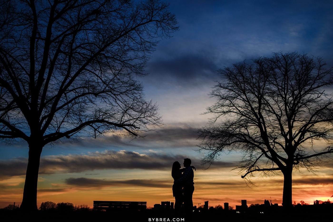 Silhouette sunset engagement photo Patterson Park