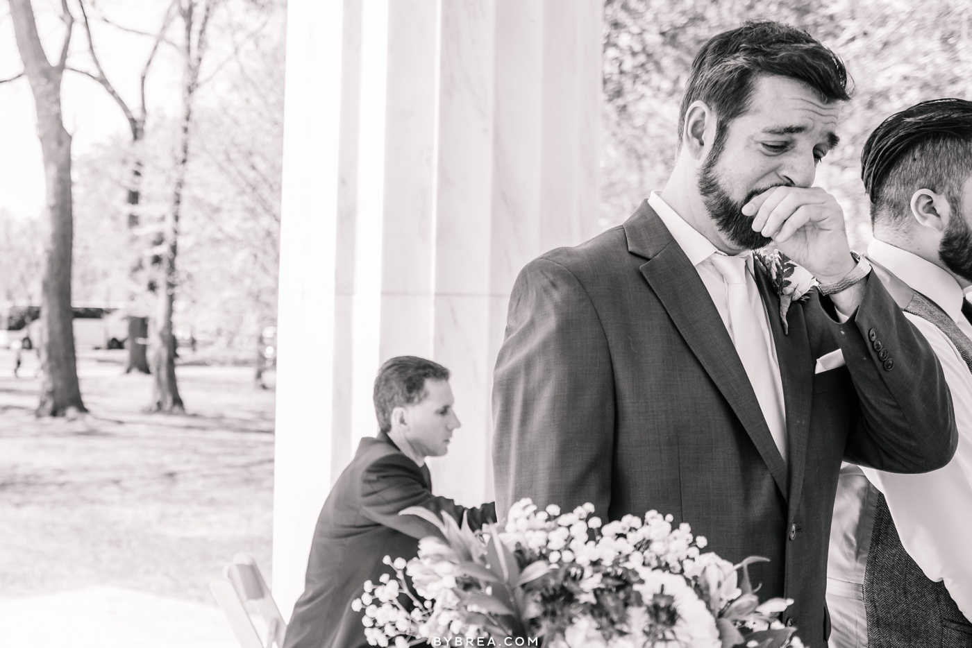 Photo of grooms reaction of seeing bride for first time D.C. War Memorial wedding