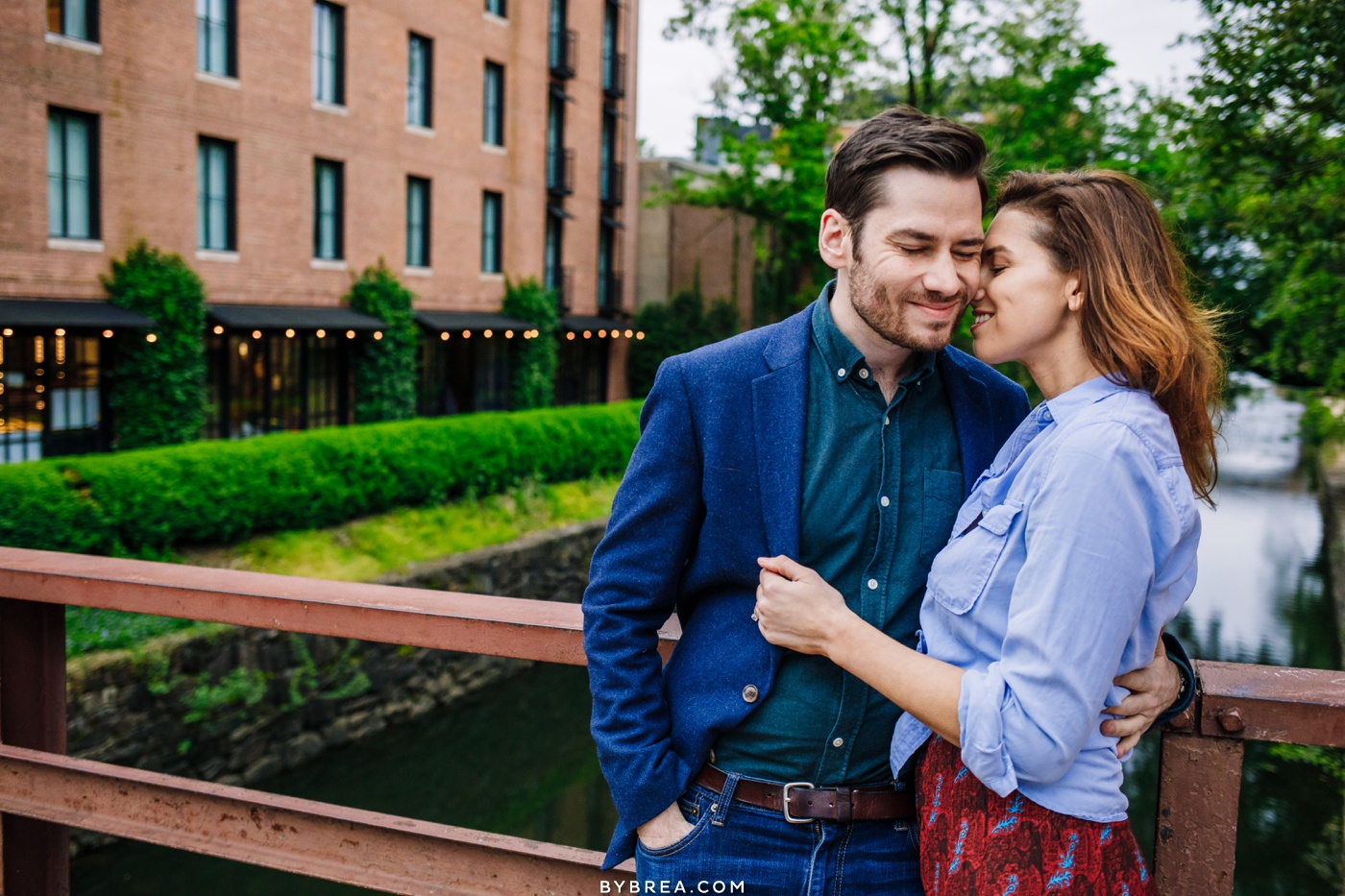 Engagement picture of couple by Georgetown canal Washington D.C.
