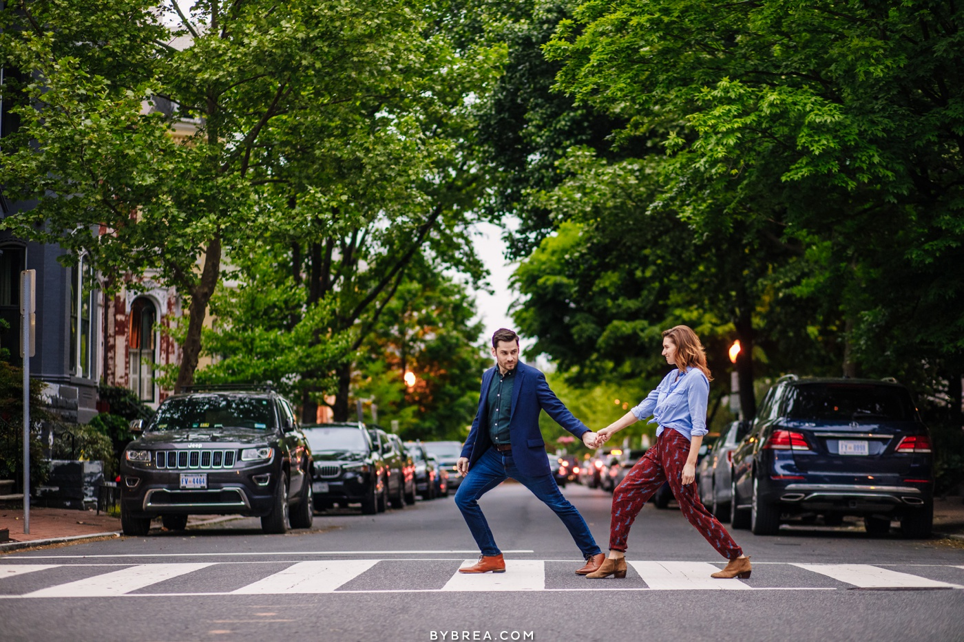 Couple crossing street during engagement session Georgetown D.C.