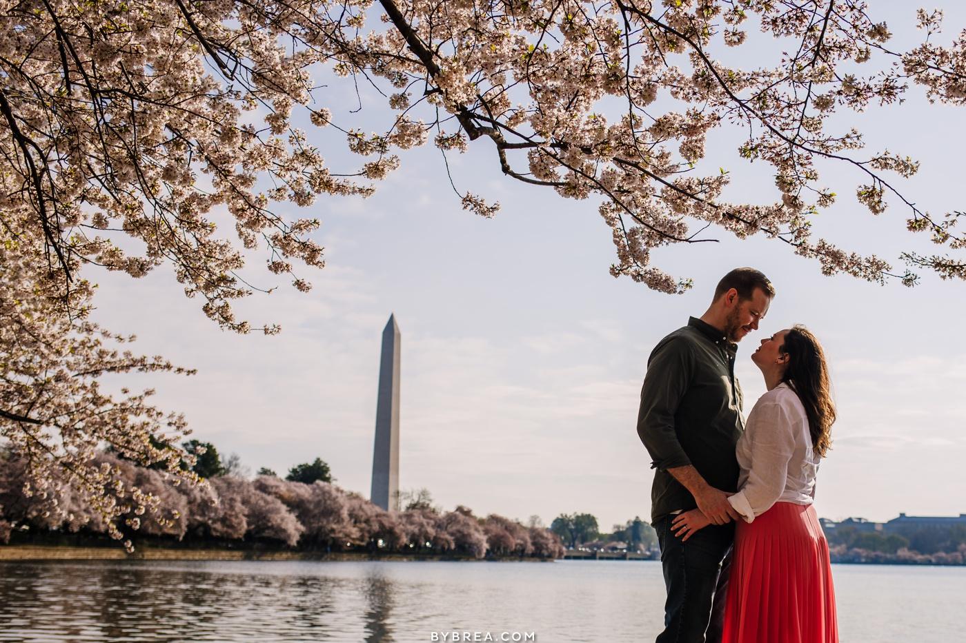 Sunrise cherry blossom engagement photo Washington Monument