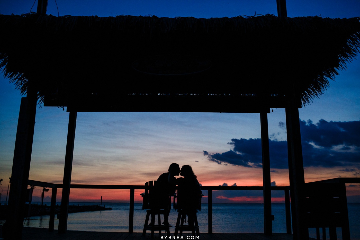 Engagement photograph of couple enjoying sunset Eastern Shore