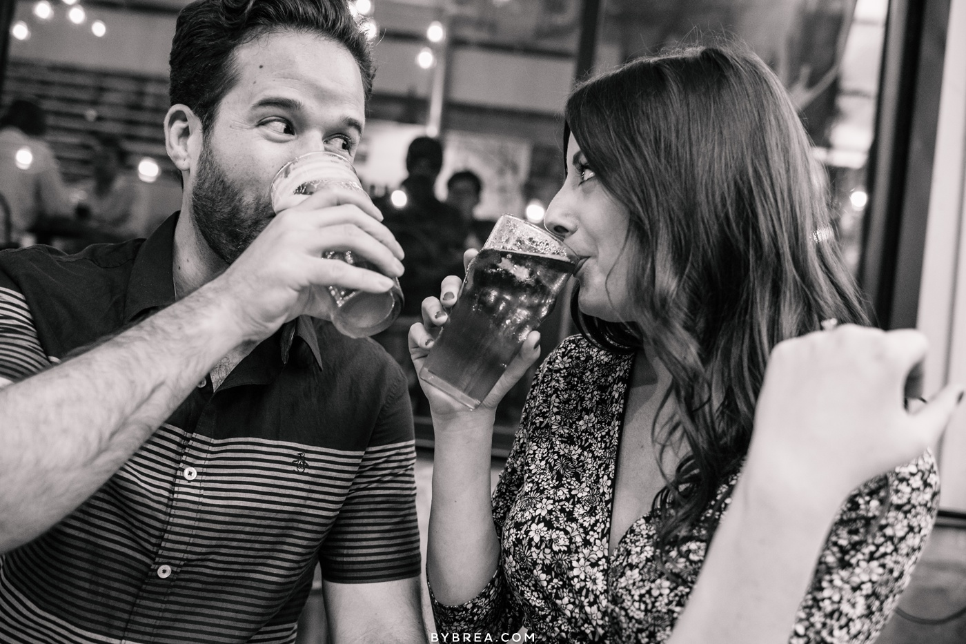 Photograph of couple enjoying a drink during their engagement shoot Vienna Virginia