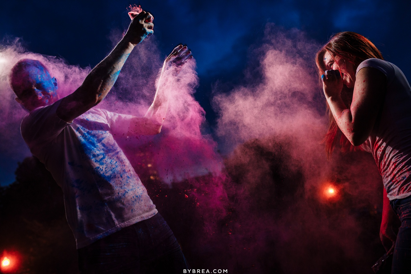 Couple having a holi powder fight night time engagement photograph Baltimore