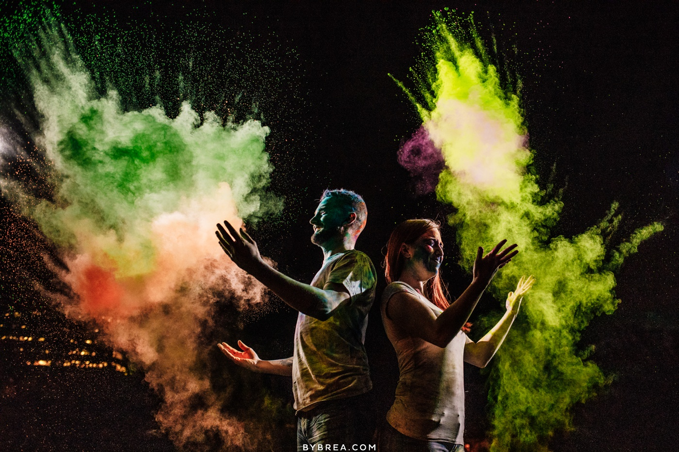 Creative night time paint powder engagement photo