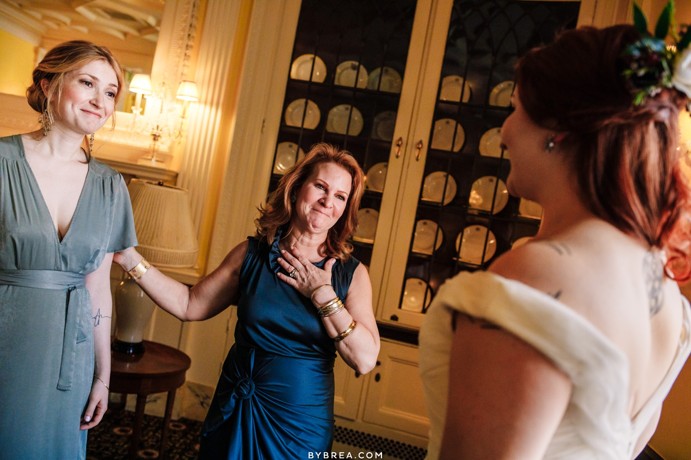 Photo of mom taking in seeing her daughter in her wedding dress Baltimore wedding