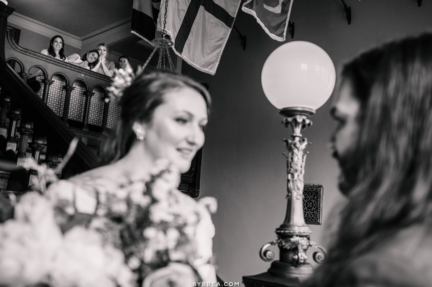 Photograph of bridesmaids watching as couple does their first look Baltimore wedding photography
