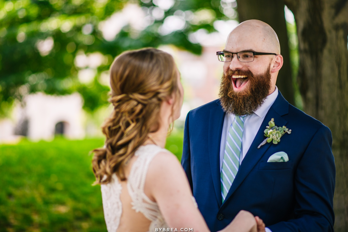 Photo of grooms during first look Baltimore wedding