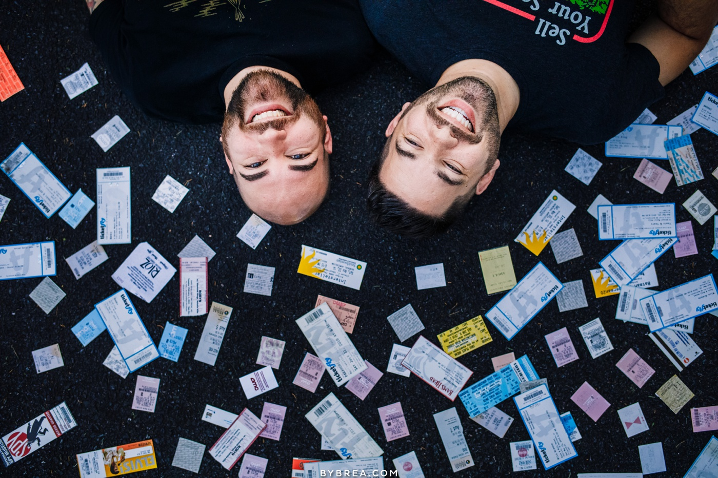 Photo of same-sex couple with all their concert tickets Baltimore