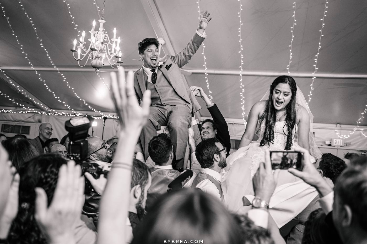 Photo of bride and groom getting lifted up during Hora Elkridge Furnace Inn
