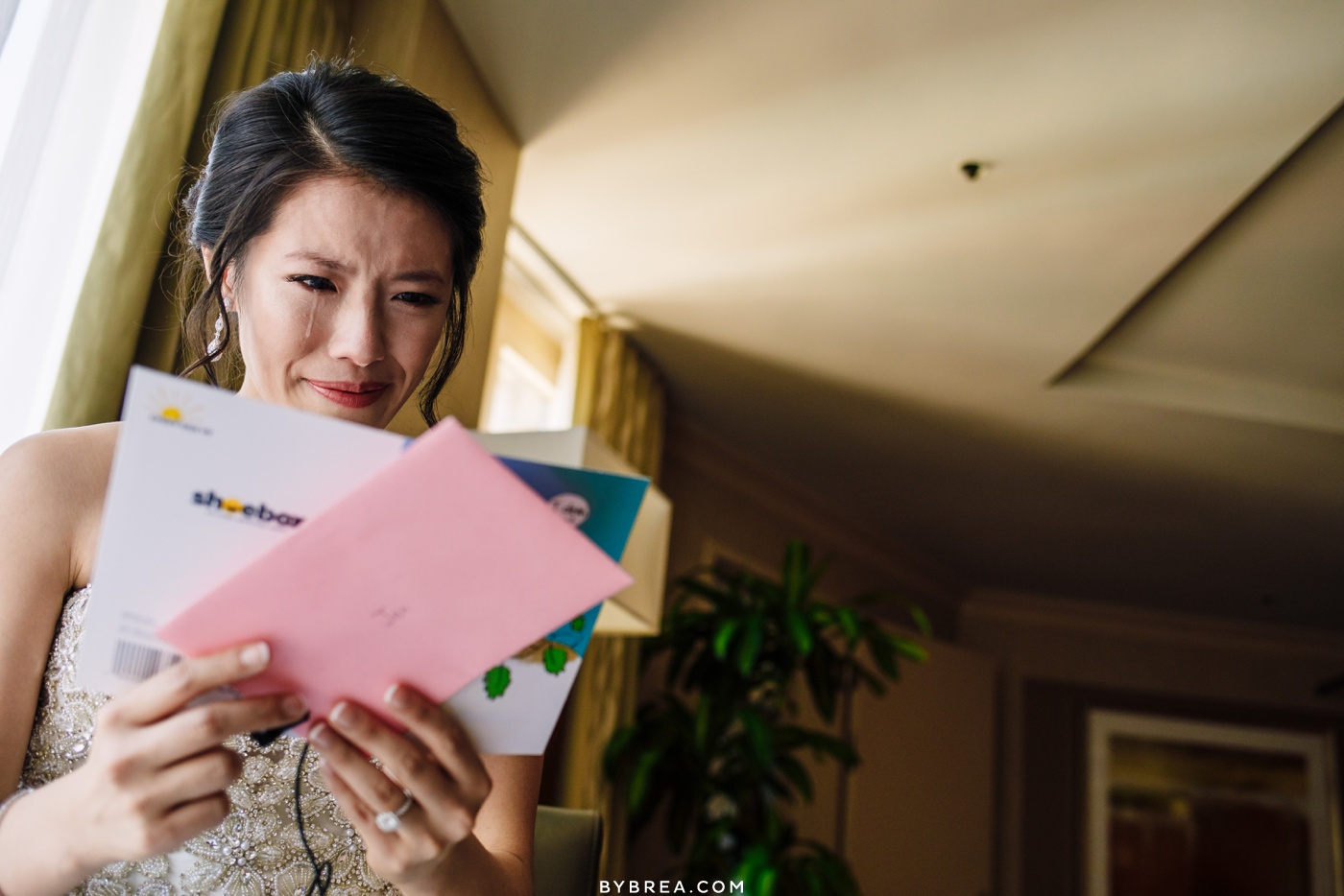 Emotional photo of bride reading letter from groom during wedding Washington D.C.
