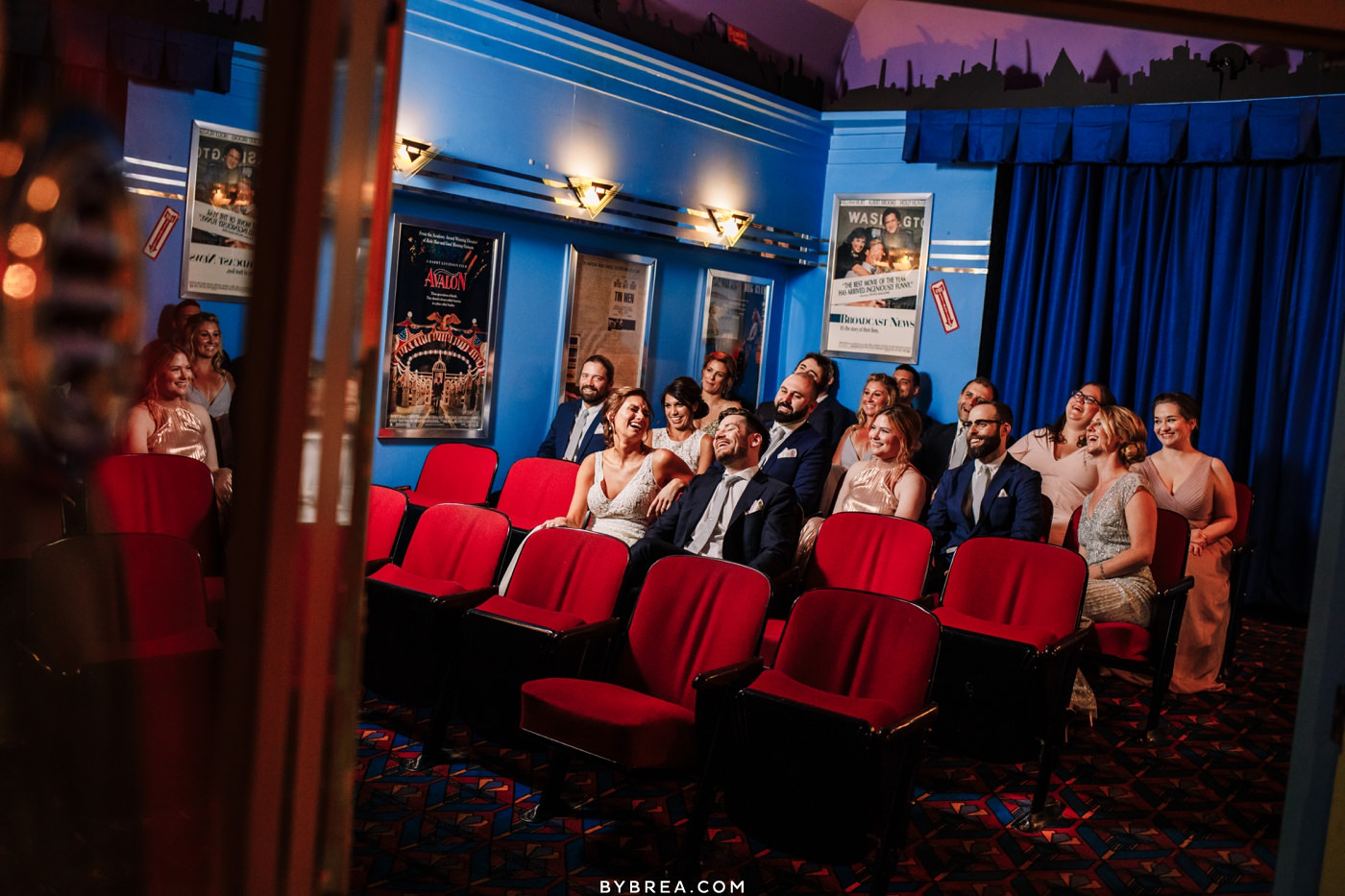 Bridal party photo inside movie theater at Baltimore Museum of Industry