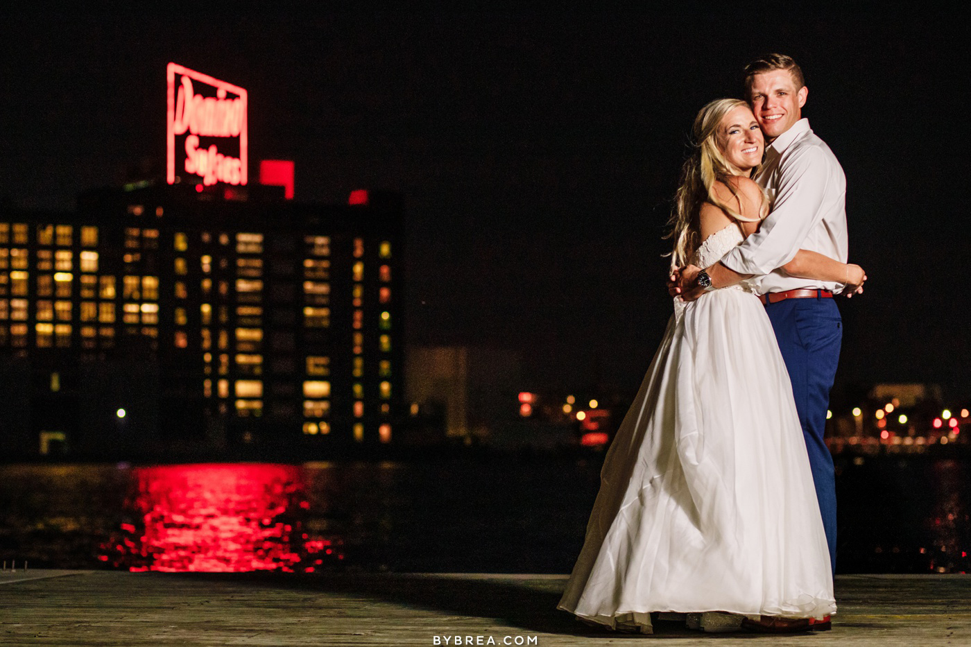 Night time portrait of bride and groom Domino Sugar sign wedding at Fredrick Douglas-Isaac Myers Maritime Museum in Baltimore