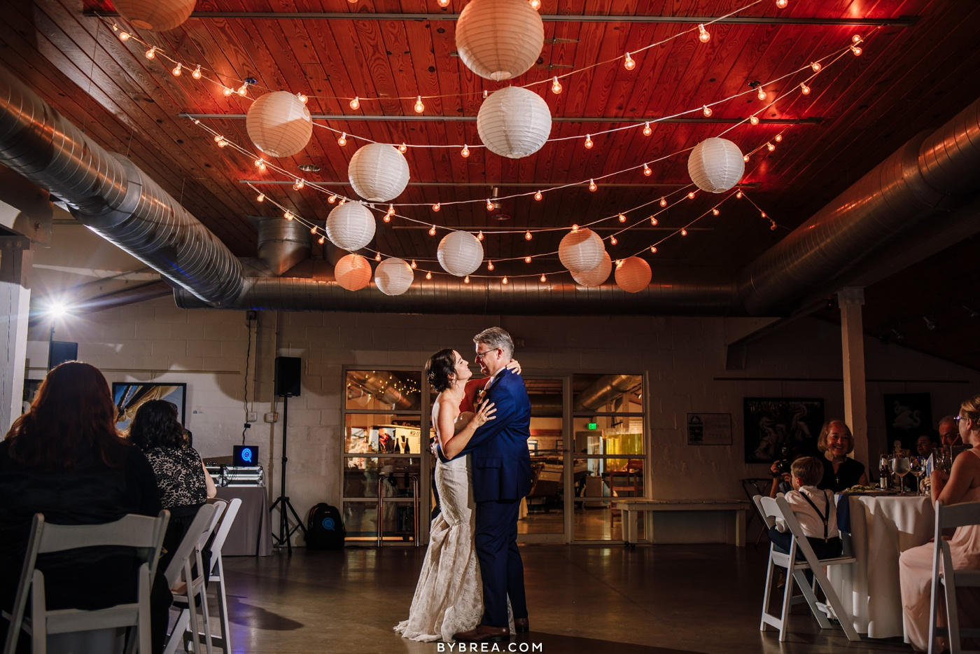 Bride and groom sharing their first dance at their wedding reception at the Annapolis Maritime Museum.