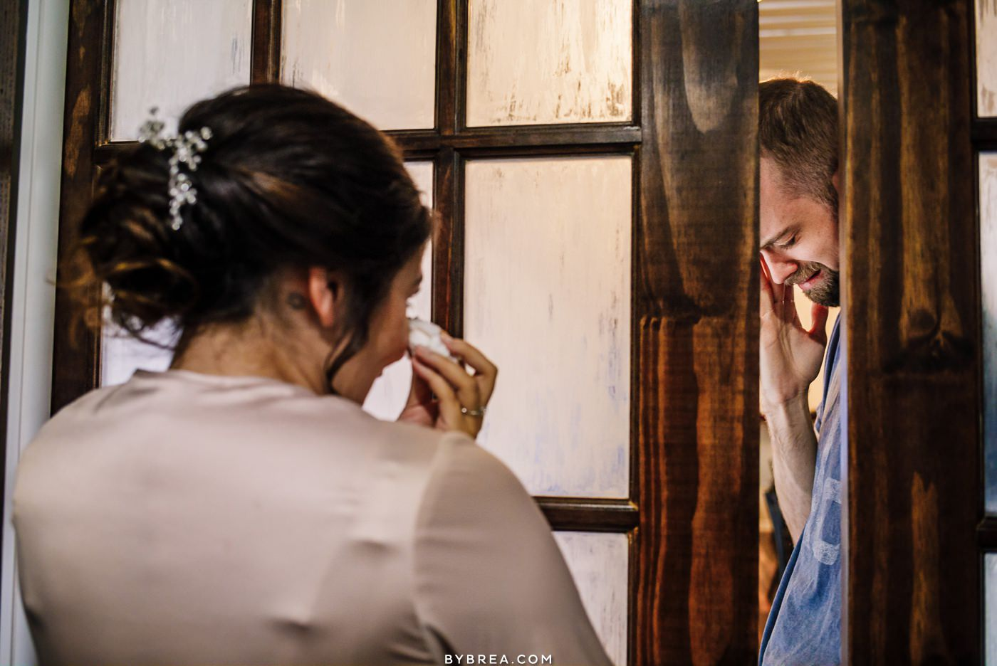 Emotional bride and groom hold hands before ceremony at Pond View Farm