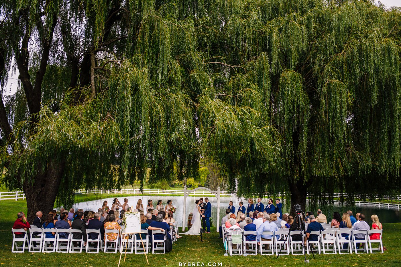 Ceremony under willow tree at Pond View Farm