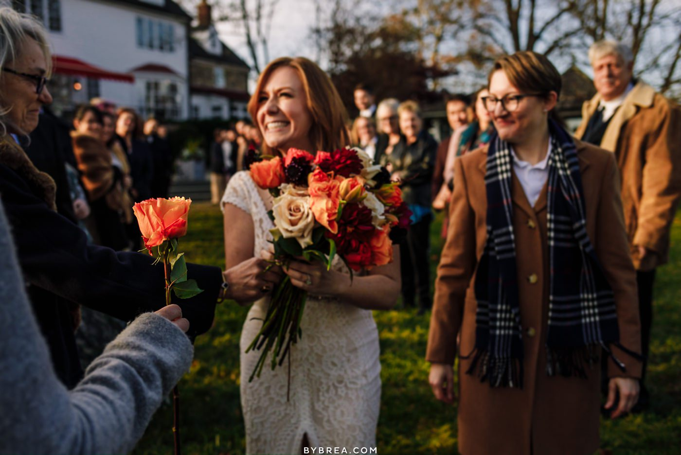 LGBTQ wedding candid of brides walking down the aisle during ceremony