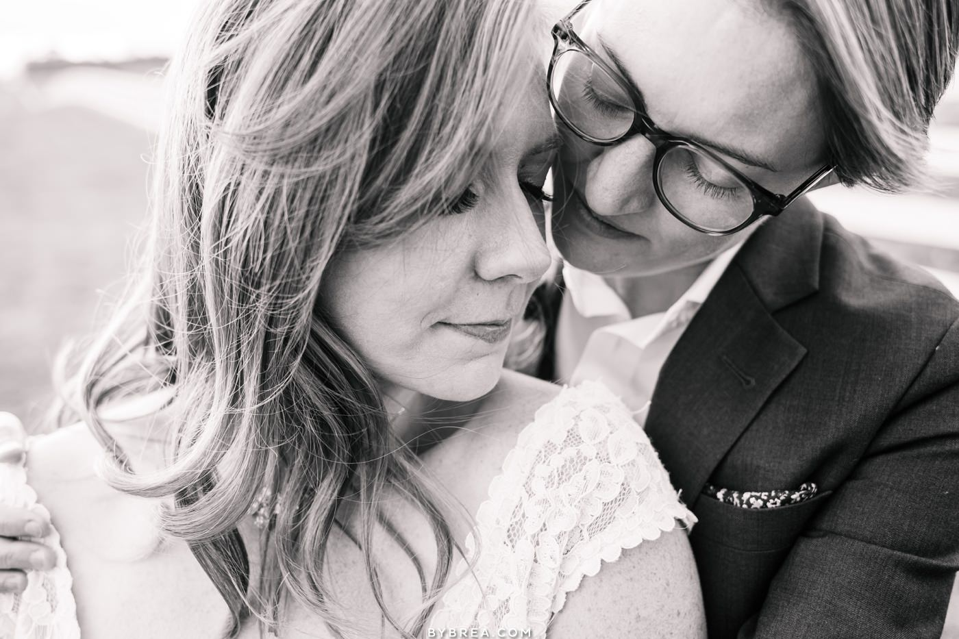 Tusculum Farm wedding photo of brides embracing each other