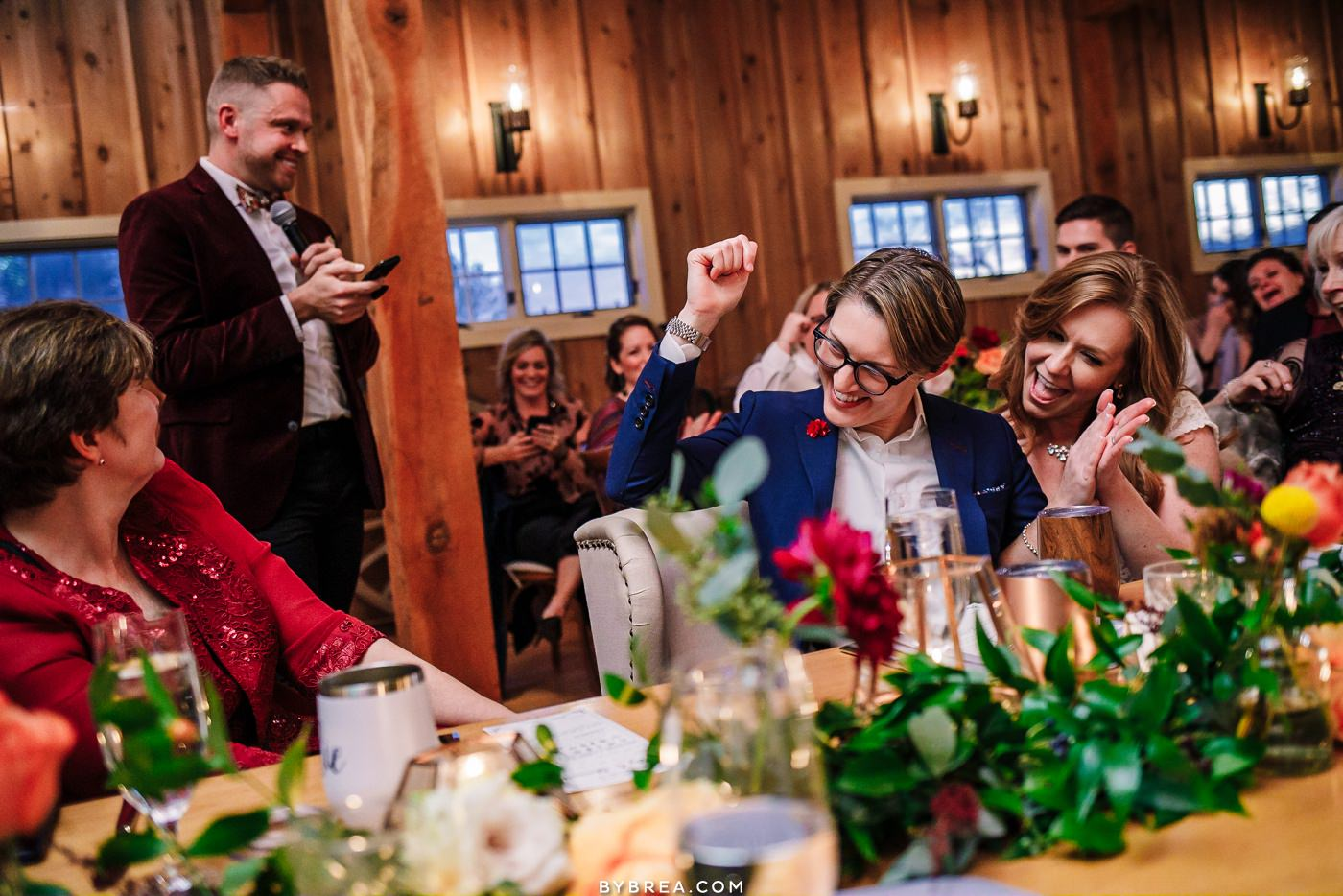 Candid moment of brides reaction during toasts at Tusculum Farms wedding