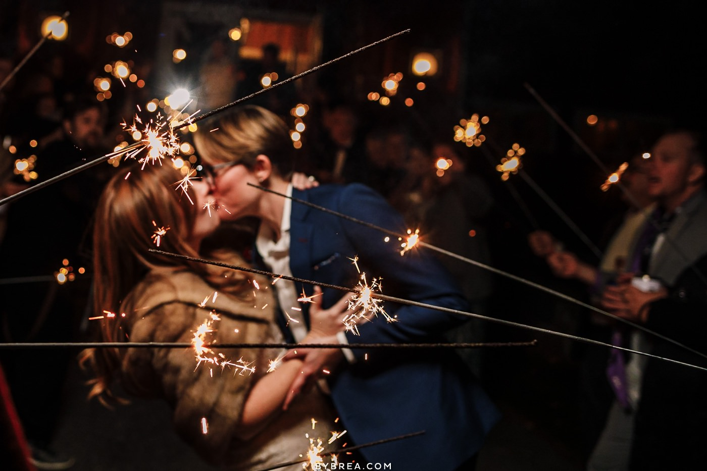 Photo of brides embracing each other during sparkler exit LGBTQ wedding at Tusculum Farms Baltimore wedding photography