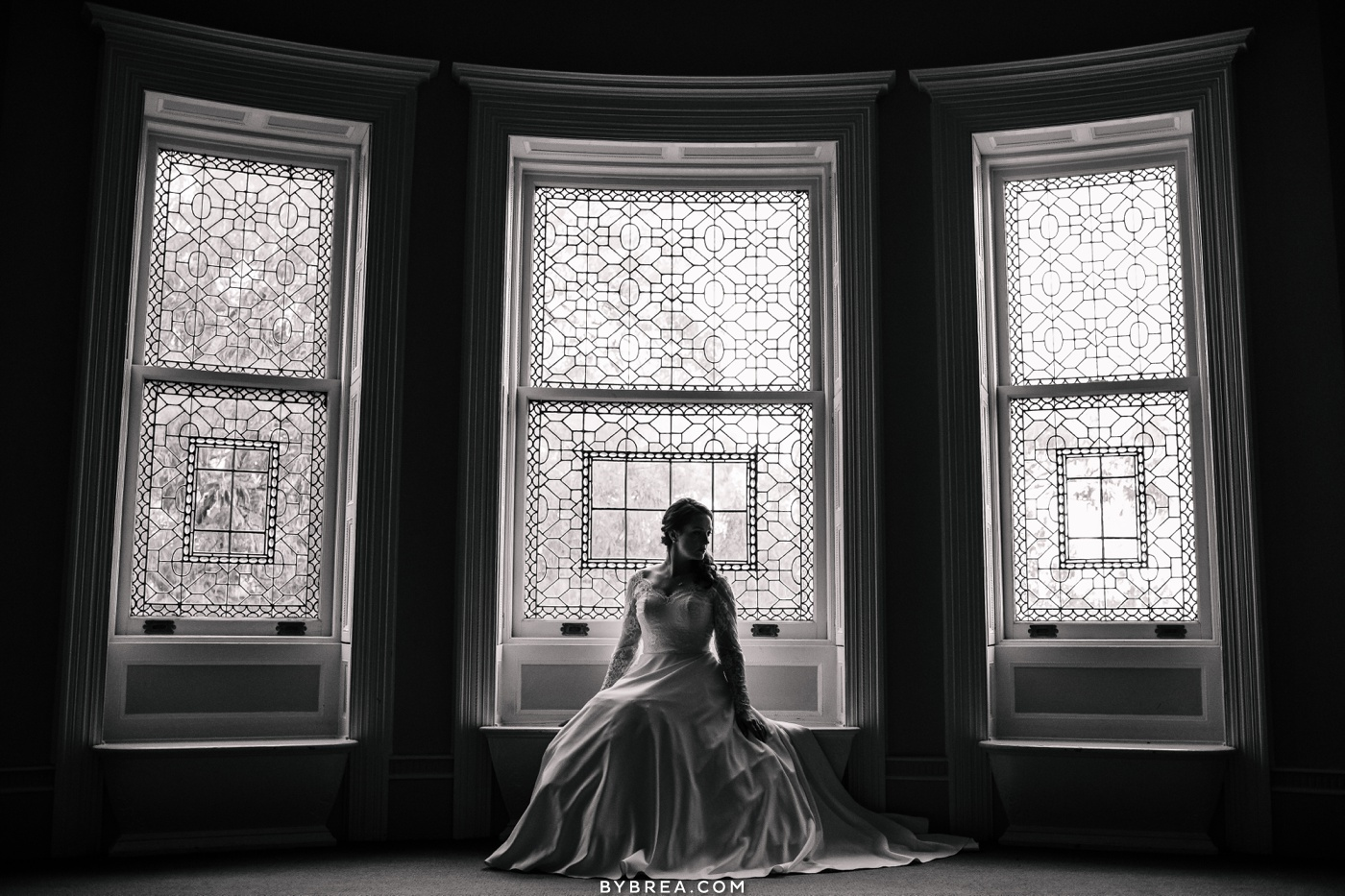 Photo of bride in window at Engineer's Club Baltimore