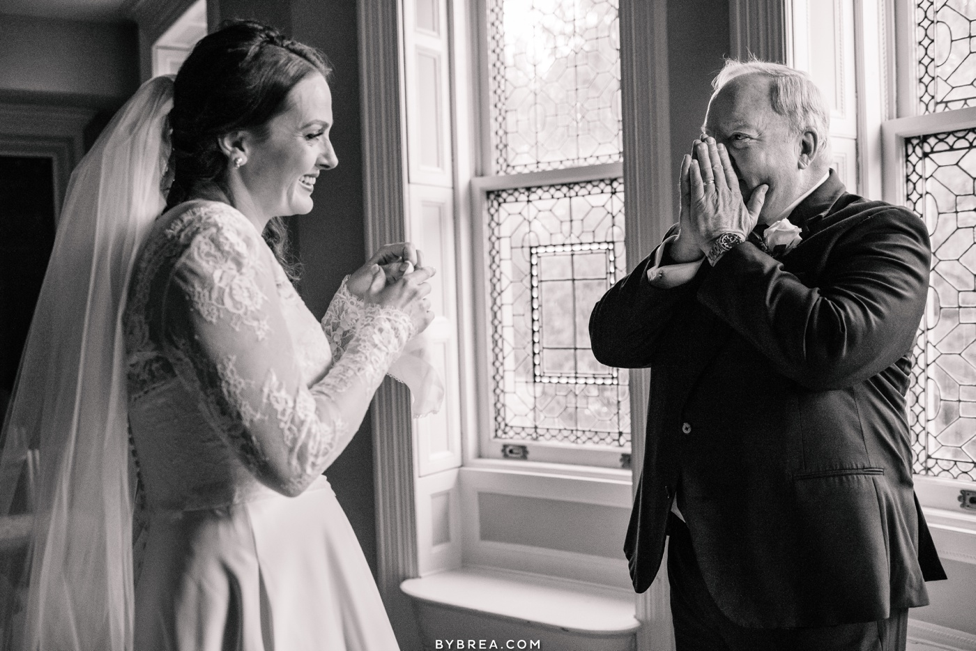 Candid photo of dad seeing her daughter in her dress during wedding at Engineer's Club Baltimore wedding photography