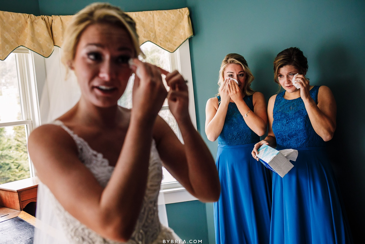 Emotional photo of bridesmaids and bride tearing up during getting ready Baltimore wedding photography