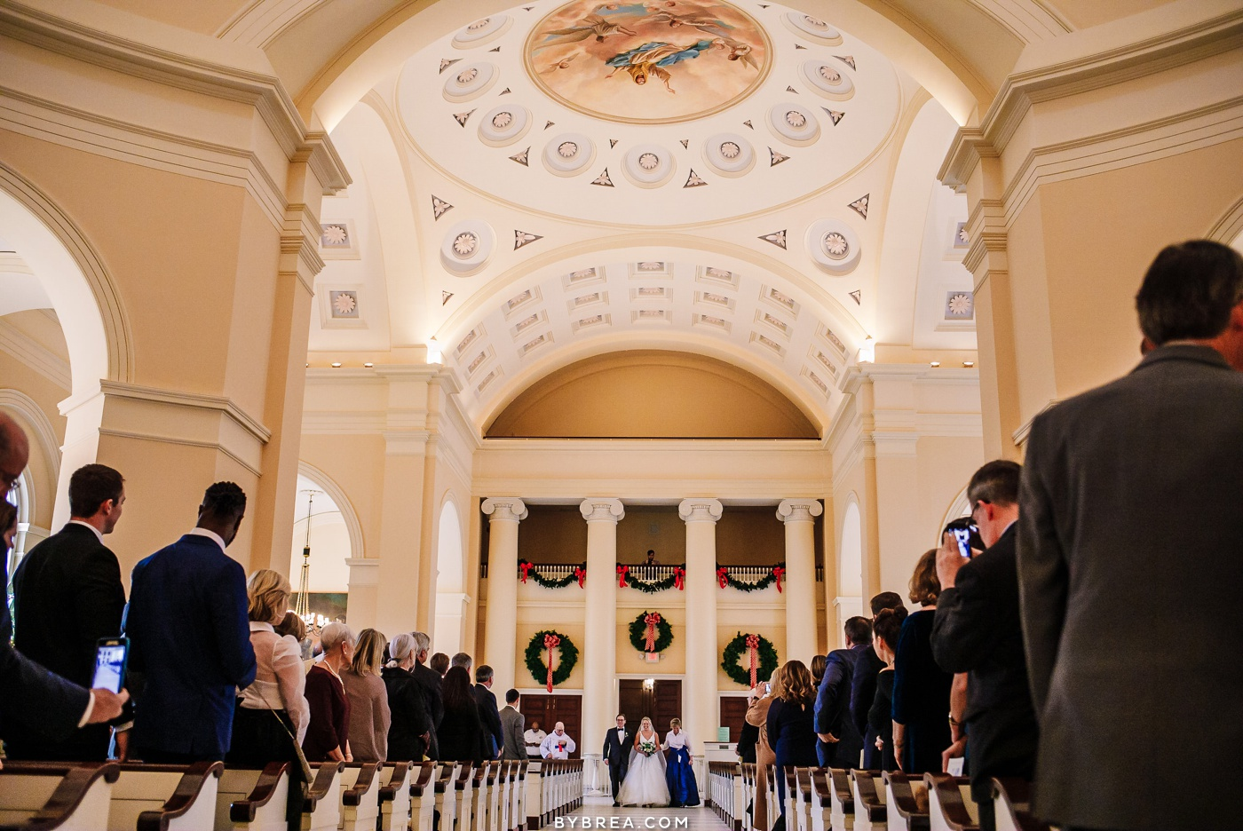 Photo of bride coming down the aisle at Basilica wedding ceremony
