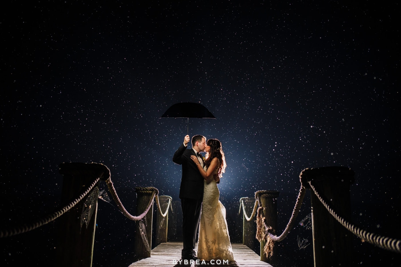 Rain on your wedding day at on a dock at night