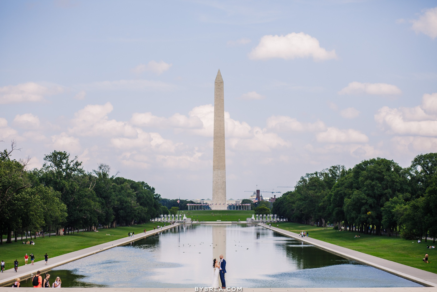 Bride and groom with washington monument and reflecting pool in DC