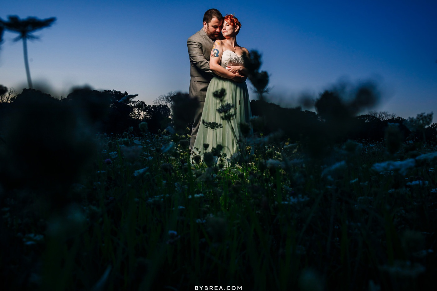 Couples' portrait in the field at Caboose Farm Wedding