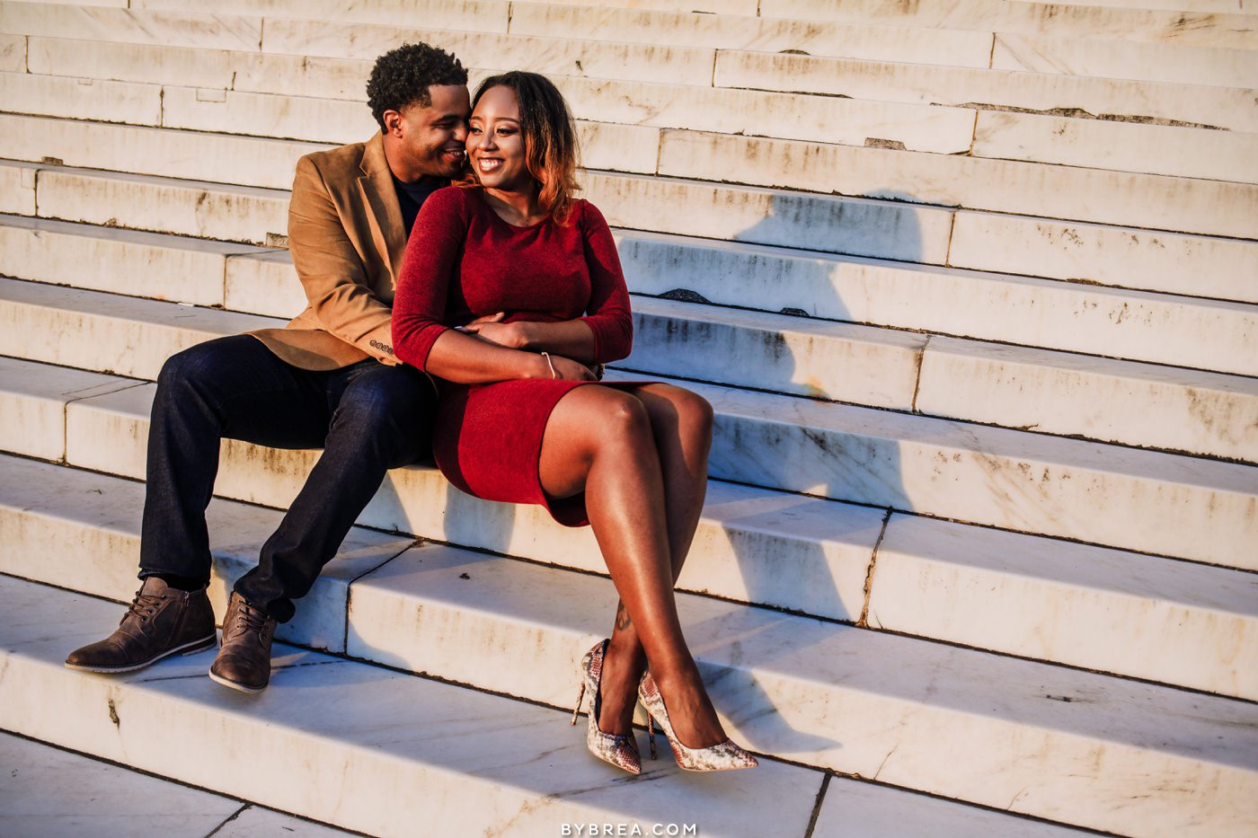 Sunrise engagement photo on steps at the Lincoln Memorial in Washington DC