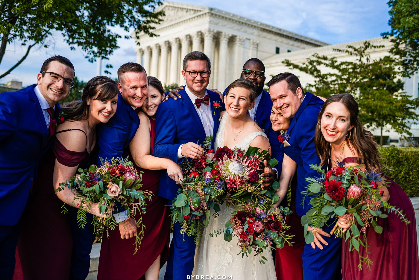 Wedding party photo outside of Supreme Court